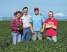 Mike Seely &#8217;84, &#8217;09 and his wife Candy have transformed their mint farm into a candy business. Now two of their children, WSU students Warren and Alayna Seely, have joined the effort. <em>Photo Bill Wagner</em>