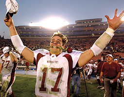 Jason Gesser celebrates the win that led to the 2003 Rose Bowl. <em>Photo Lucy Nicholson/Associated Press</em>