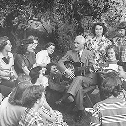 President Wilson Compton playing guitar in his garden for students. From LIFE magazine, May 1951