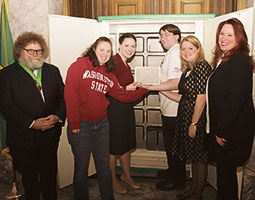From left: Centennial Time Capsule Project mastermind Knute Berger, Kim Berlin '03, Jennifer Estroff '03, Eric Meadows, Jessica Gordon, and Secretary of State Kim Wyman place the 2014 container. <em>Courtesy Washington Secretary of State</em>