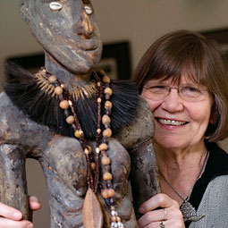 Ellen Dissanayake with a carving of a 'yam goddess' from Papua New Guinea.