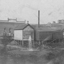 McConnell-Champes Dry Goods Store, Pullman, 1892. Rear of McConnell-Champes Dry Goods Store, showing artesian well.