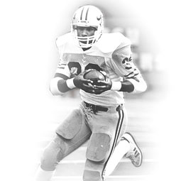 Rueben Mayes '92, '00 M.B.A, carries the ball in the historic 1984 game against Oregon. Photo Kevin Morris-U. Oregon.