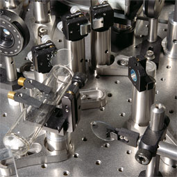 An array of mirrors and lenses directs six laser beams into Engel's magneto-optical trap.