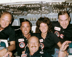 Inflight view of the crew on the flight deck of STS-7. Left to right are Norman E. Thagard, mission specialist; Robert L. Crippen, crew commander; Frederick H. Hauck, pilot; Sally K. Ride, mission specialist; and John M. Fabian '62, mission specialist. Courtesy NASA.
