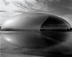 The National Theater in Beijing, an enormous domed structure which houses several theaters and is surrounded by a continuous moat of water.