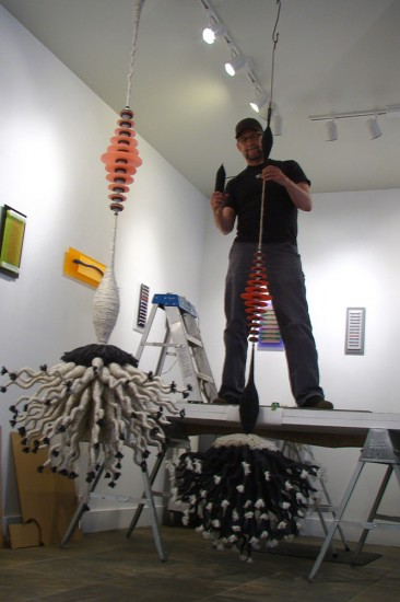 Joel Allen installing his work.