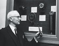 Homer Dana with first four microphones used By KFAE/KWSC. Courtesy WSU Manuscripts, Archives, and Special Collections