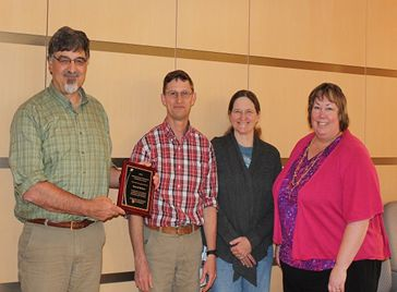 Darrel Nelson, second from left, stands with Steve Simasko, Cynthia Faux and Becky Morton who all nominated Darrel for his outstanding contributions to WSU Pullman.