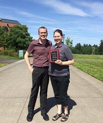 Nikki Hinshaw stands with Nolan Yaws who nominated her for her outstanding contributions to WSU Vancouver.